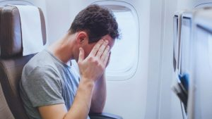 Should you recline your seat on an airplane? This guy doesn't have that problem.