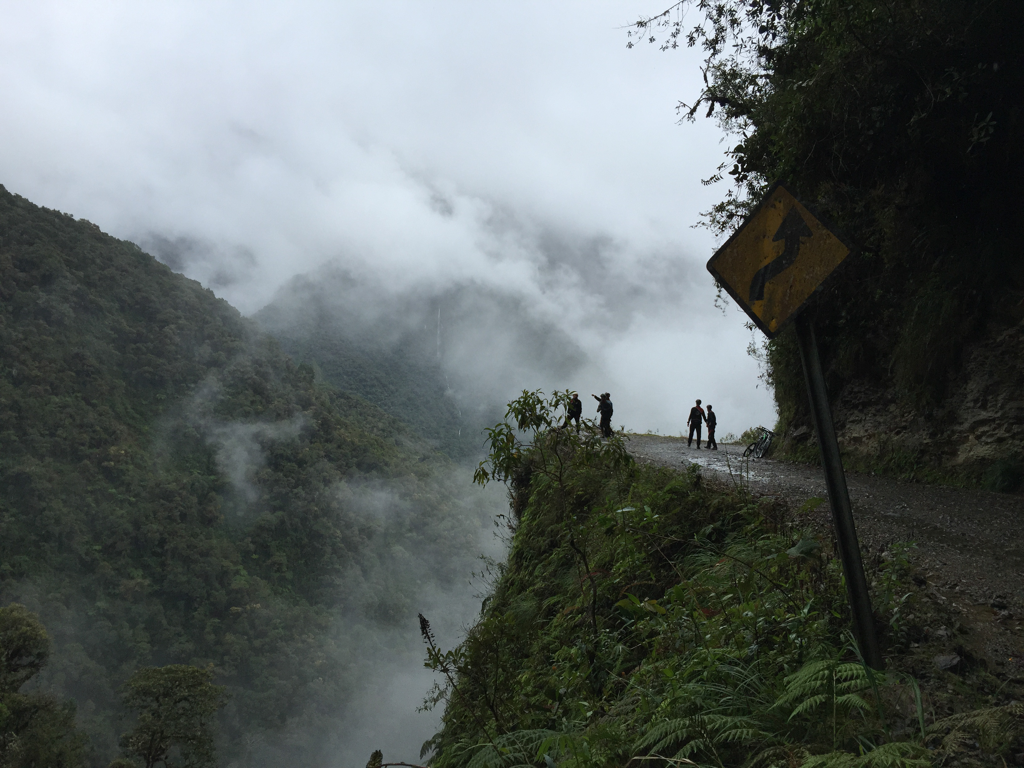 figures overlooking death road bolivia