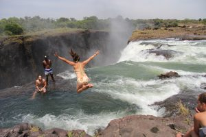 girl jumping into devil's pool zambia