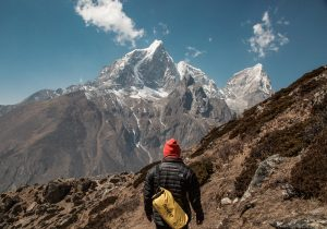 Man in red hat everest mountain