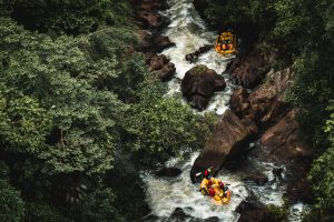 two boats white water rafting on river