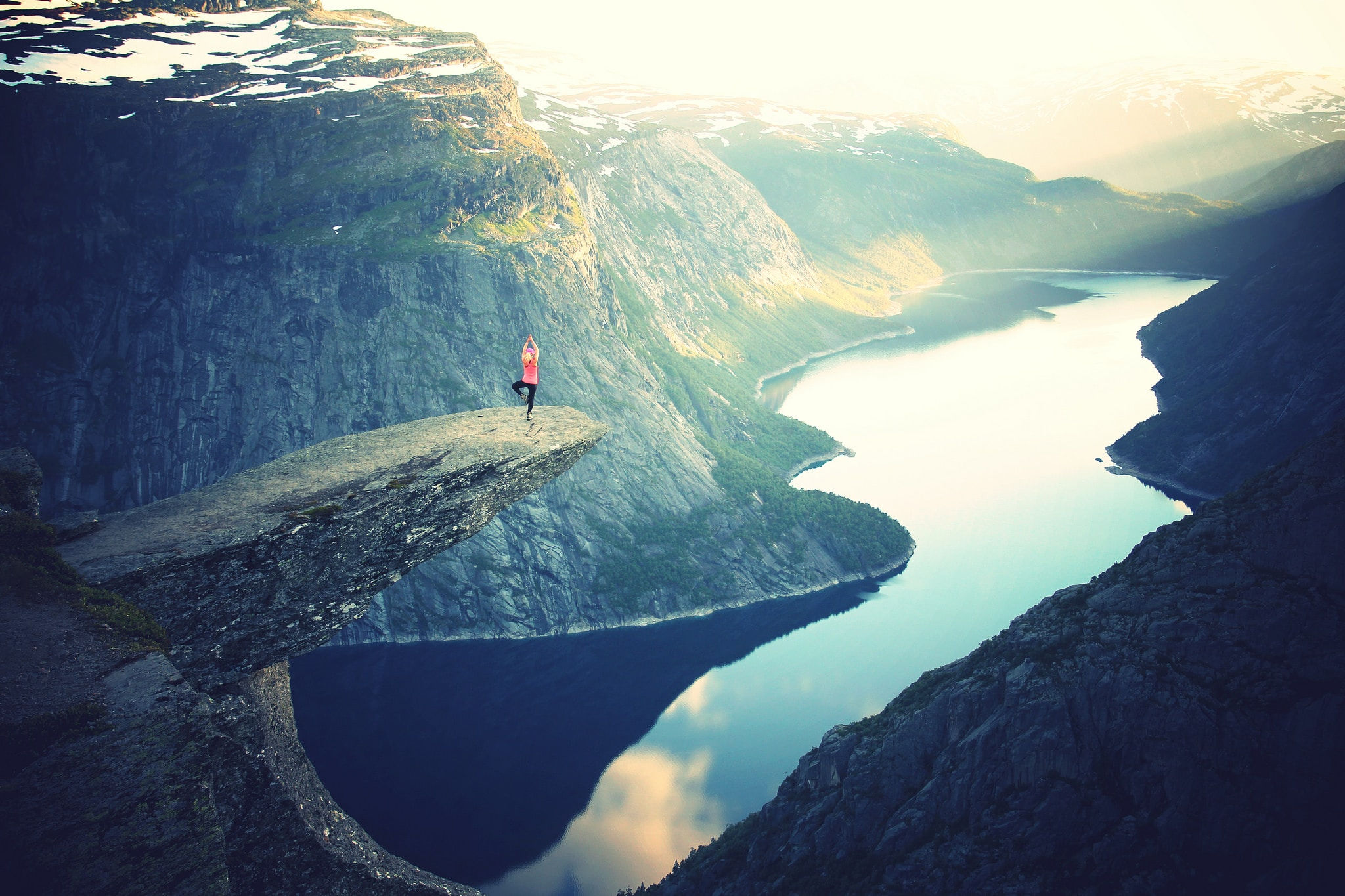 Trolltunga rock Norway yoga pose